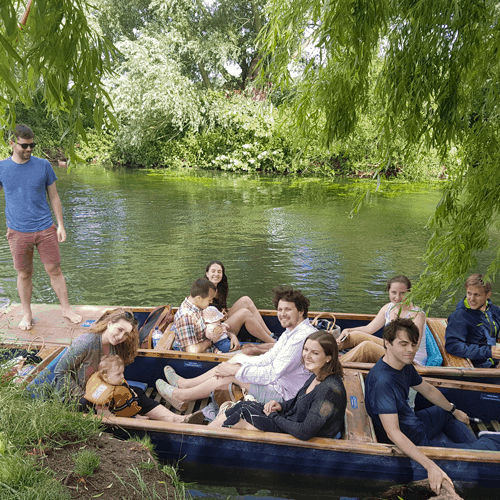 Group punting down the river Cam